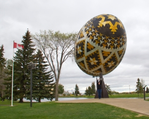Vegreville Pysanka. So BIG. Look how tiny I am next to it!